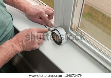 Installing Weathering Insulation - stock photo