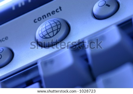 Instant Access: connect button on a computer keyboard leads the way to the world wide web at the push of a button. Selectively focused on connect button.