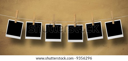 Instant Camera Frames on a leash on a textured background. - stock photo