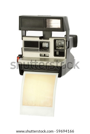 Instant camera, with empty print - stock photo