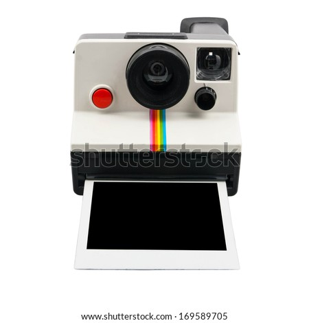 Instant camera with photo coming out - stock photo