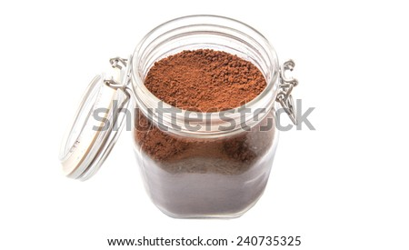 Instant coffee drink powder in glass jar container over white background  - stock photo