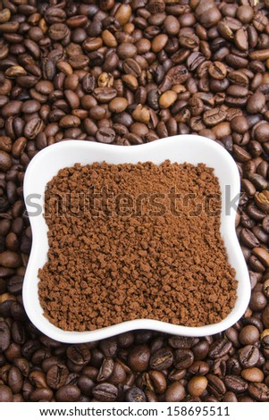 instant coffee on coffee beans background