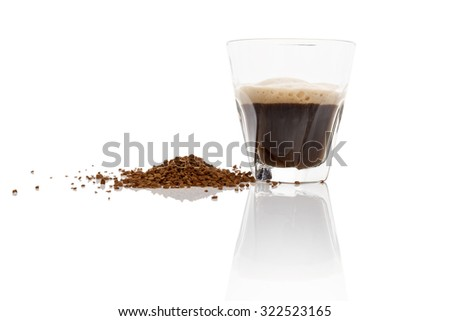 Instant coffee powder and delicious aromatic coffee in glass isolated on white background with reflection. Culinary coffee drinking.  - stock photo
