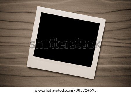 instant film on wooden wall - stock photo