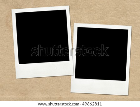Instant frames on old paper background