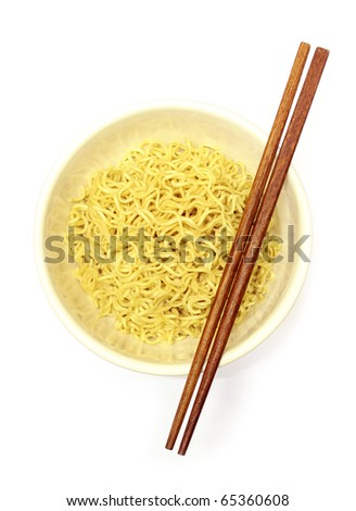 Instant noodles in bowl and chopsticks - stock photo