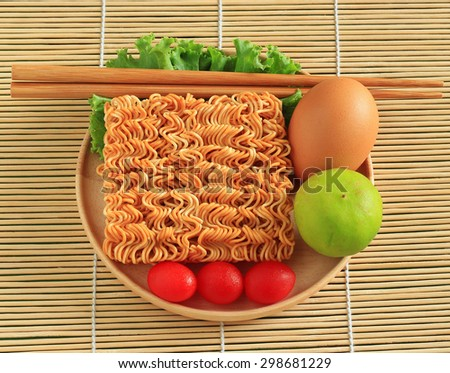 Instant noodles in wooden bowl with wooden background - stock photo