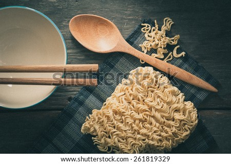 Instant noodles on wood table with film filter effect - stock photo