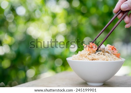 Instant noodles with pork and shrimp in a bowl - stock photo