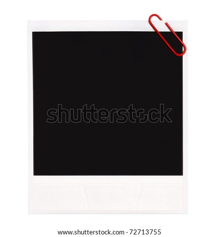 Instant old photo with red paper clip isolated on white background. - stock photo