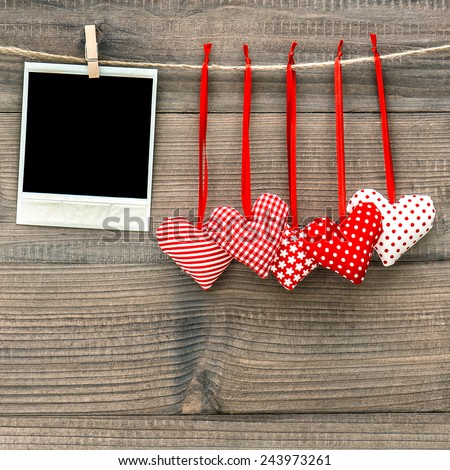 Instant photo frame and red hearts. Valentines Day concept - stock photo