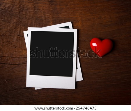Instant photo frames with red heart - stock photo