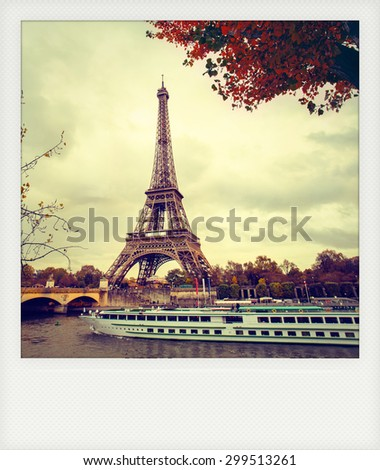 Instant photo of  The eiffel tower in paris, while a boat cruise along the Seine - stock photo