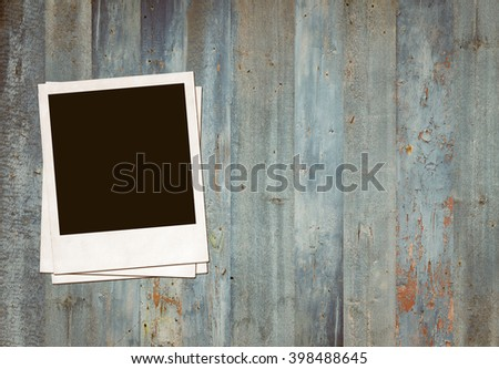 Instant photo on wood. Polaroid photo frame on wood  - stock photo