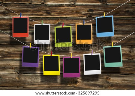 Instant photos in polaroid style hanging - stock photo