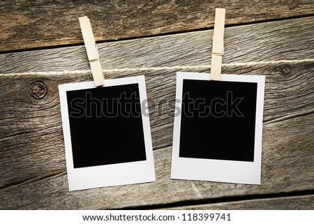 Instant Photos on a wooden background - stock photo