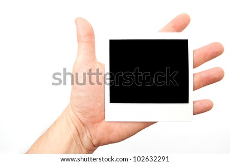 instant picture in hand - stock photo