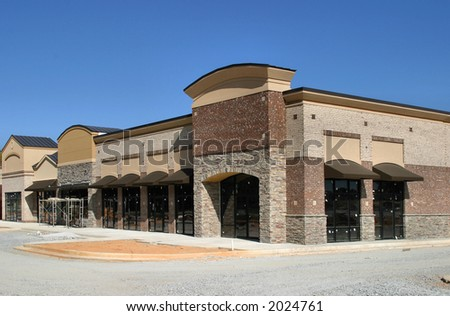 Instant Village.  A suburban shopping center under construction, designed to look like a small town street. - stock photo