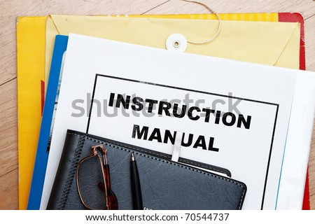Instruction Manual abstract with manila envelop and diary - stock photo