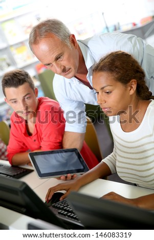 Instructor in training class with students - stock photo