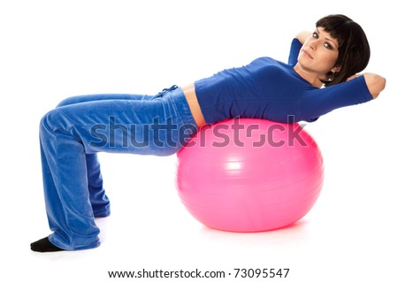 instructor showing exercises using fitball at gym to people - stock photo