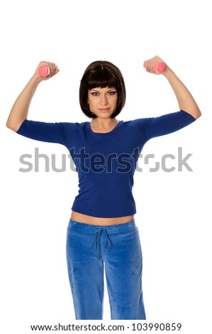 instructor showing to people exercises using dumbbells at gym - stock photo