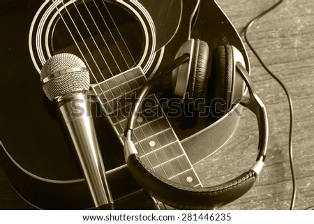 instrument guitar headphones and microphone