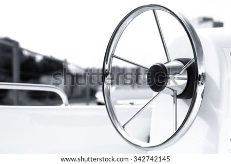 Instrument panel and steering wheel of a motor boat  - stock photo