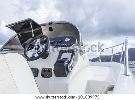 Instrument panel and steering wheel of a motor boat cockpit - stock photo