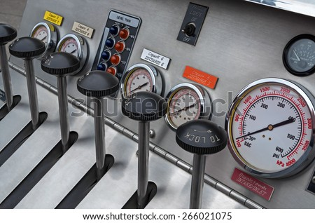 Instrument panel of a fire truck made of stainless steel and plastic. - stock photo