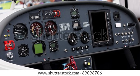 Instrument panel of a small airplane. Focus is on the left half of the image. The altitude and airspeed dials are easily readable at full size. - stock photo