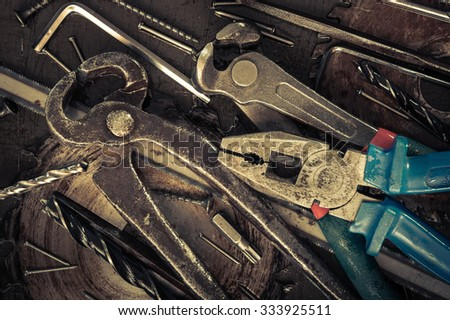 Instruments and tools background. Vintage old desktop. Toned. - stock photo