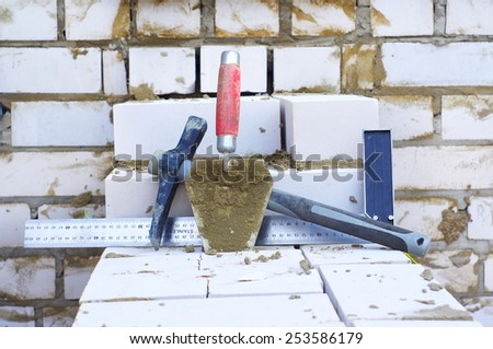 Instruments for wall made of bricks - stock photo