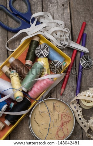 Instruments of repairman clothing  and thread - stock photo