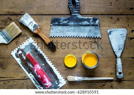 instruments set for decorating and building renovation on wooden background top view