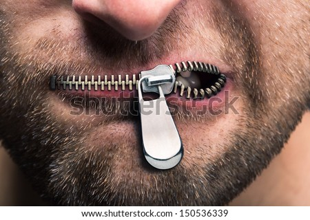 Insubordinate man with zipped mouth - stock photo