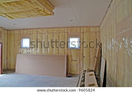 Insulated garage attached to new single family residence - stock photo