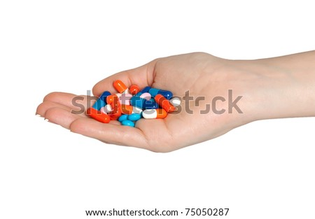 Insulated Hand with pills - stock photo