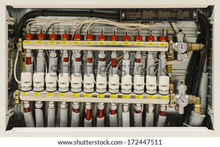 Insulated pipes and valves in a centralized heating and air conditioning system - stock photo