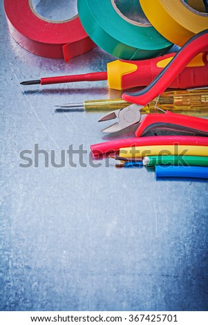 Insulating tape electric cables insulated screwdriver cutting pliers construction concept. - stock photo