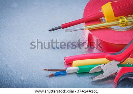 Insulating tape electric cables insulated screwdriver nippers construction concept. - stock photo