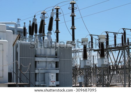 Insulation and switches in a power plant - stock photo