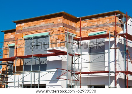 Insulation for thermal protection to the shell of the house. Save energy. - stock photo