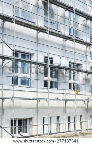 Insulation for thermal protection. Work on scaffolding. - stock photo