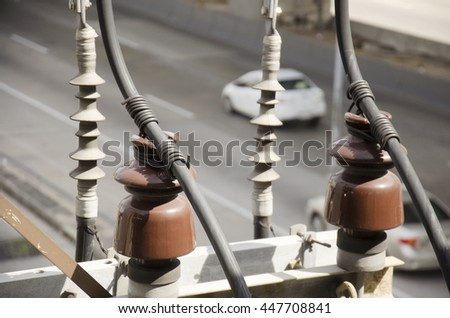Insulator on electricity pillar or Utility pole at beside road in Bangkok, Thailand - stock photo