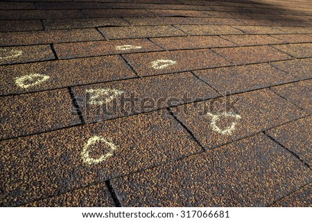 Insurance Adjuster marked hail damage on a insureds roof. & Insurance Adjuster Stock Images Royalty-Free Images u0026 Vectors ... memphite.com