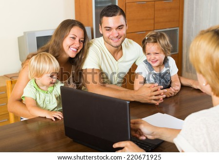 Insurance agent consulting happy young family with kids indoor  - stock photo