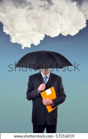 Insurance agent holding umbrella under huge rainy cloud - stock photo