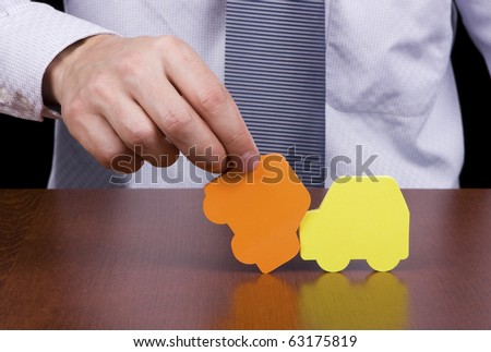 Insurance agent simulating a car accident - stock photo